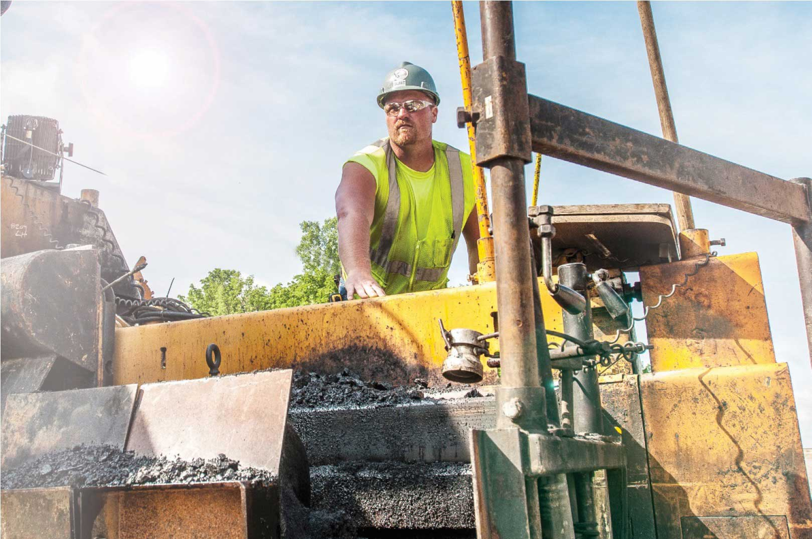 Man riding on construction equipment
