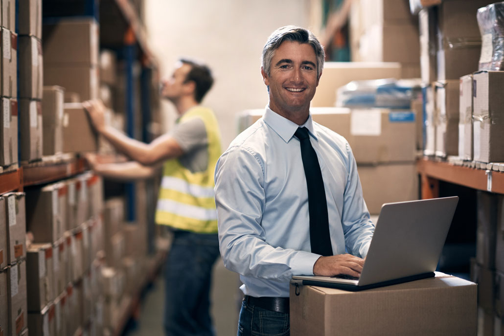 gray haired man in warehouse